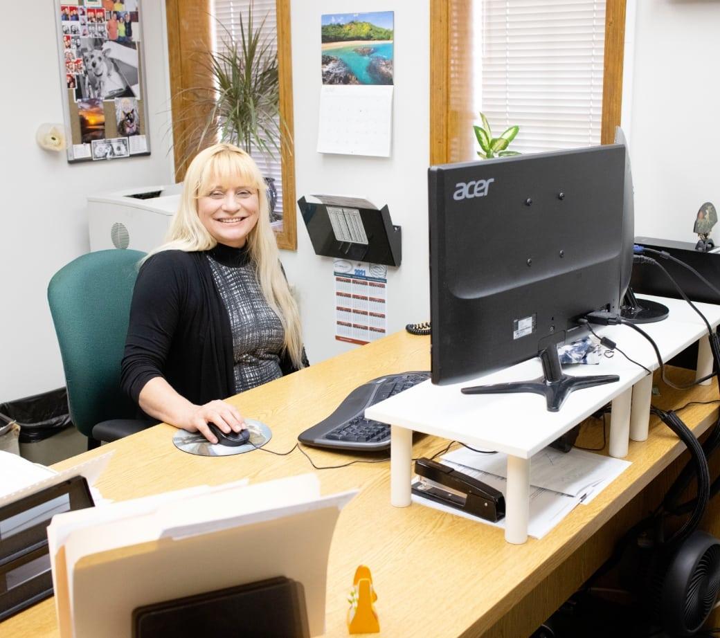 mcguire-employee-at-desk